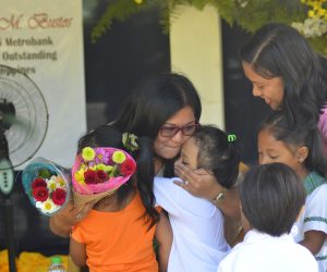 CONGRATULATIONS. Well-wishers express their greetings and salutations to Dr. Katherine Faith M. Bustos for her exemplary performance and outstanding dedication to the teaching profession. (From left photo) With her are the kindergarten pupils with their teacher, Mrs. Melany Rose L. Pasion.