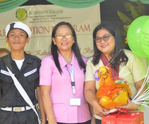 Dr. Bustos with Mrs. Marissa J. Taguinod, HS principal, and Raymar Donato; Photo: Rodel Balallo
