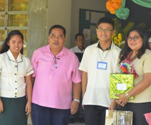 Madam Kathy with Dr. Romeo M. Bicad, Dean of School of Informatics & Hospitality Management, Jayson Calanga and Yrah Grace Domingo.(Photo by Rodel Balallo)